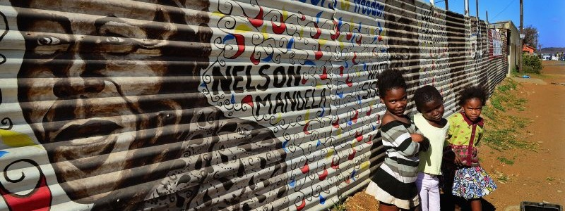 Children walked near mural Nelson Mandela Johannesburg South